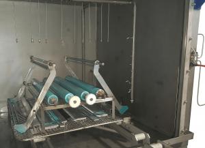 Machine parts being decontaminated in ATEX washer