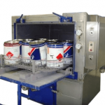 Paint buckets decontaminated in an atex washer